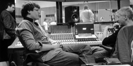 men sitting in recording studio